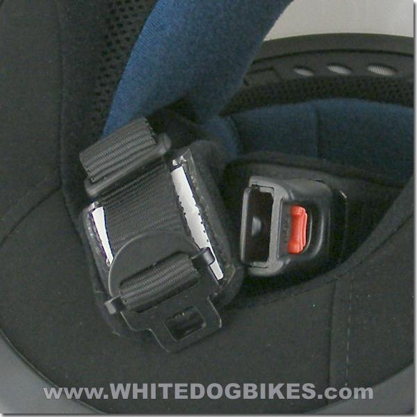 Open quick release helmet buckle close up